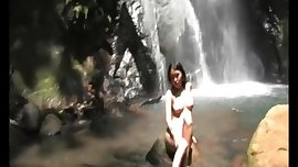 beautiful naked asian by the waterfall