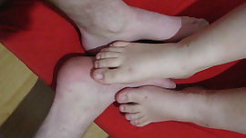 playing footsies with a young neighbor girl