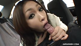 Slutty sexy Asian bitch sucking a cock in the car